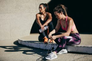 fit-females-resting-postworkout-jump-rope